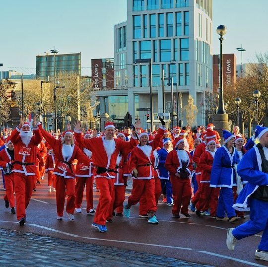 Christmas arrives early in city as 6,000 Santas dash through Liverpool